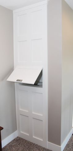 Built in laundry chute in hallway wall #bellahomesiowa