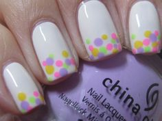 Base is by Orly in Tempting Tea Rose. For the dots  3 of the colors from the new China Glaze City Flourish collection. The green is Grass is Lime Greener, pink is Thistle Do Nicely and the purple is Lotus Begin. The yellow is OPI's I Just Can't Cope-acabana from the new Brazil.
