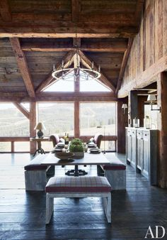 Rustic Dining Room by Markham Roberts Inc. and JLF & Associates Inc. in Big Sky, Montana