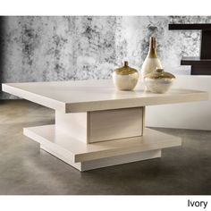 Modernize your home decor with this Wakiaka Pagoda Coffee Table. This unique piece features an eye-catching design and multiple color options.