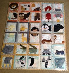 Animal Adventure Quilt  I made for my new grandbaby due to arrive in fall 2015!  Designs are by Anita Goodesign