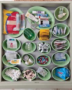 The kitchen is command central in most homes, so keep basic first-aid supplies there. Martha arranges items in little containers.