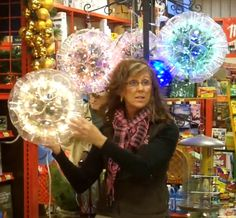 Sparkleball made out of 50 clear solo cups and a string of Christmas lights - quick and easy