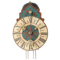 South German polychrome painted wall clock, circa 1710