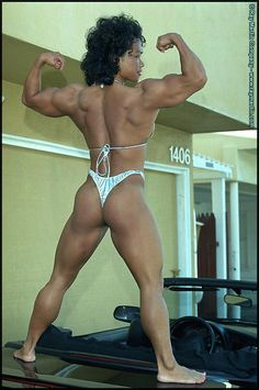 Female Bodybuilder Dawn Riehl flexing her impressive muscles!
