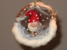 This little felt gnome in a walnut shell could double for a Santa ornament.