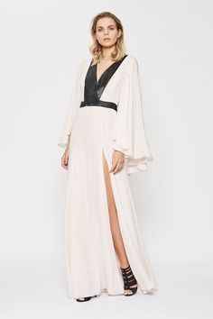 A beautifully feminine option for your next evening event, the Illusion Kaftan Dress offers a soft and fluid line that drapes the silhouette. Dramatic kaftan inspired cutting through the sleeves adds dimension to the look. Amanda Wakeley, Luxury Dress, Kaftan, Illusions, Designer Dresses, Duster Coat, Feminine, Sleeves, Jackets