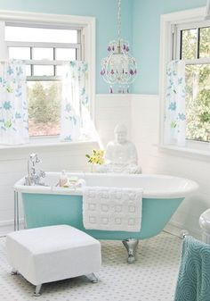 This aqua clawfoot tub obviously brings the entire room together, but the combination of bright whites and cool hues really gives this bathroom a great energy. The plethora of natural lighting in this space is key to its success!    xx  ESK