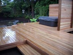 Mahogany deck with hot tub this would look cool in cement as well