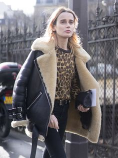 An aviator jacket paired with a leopard sweater.