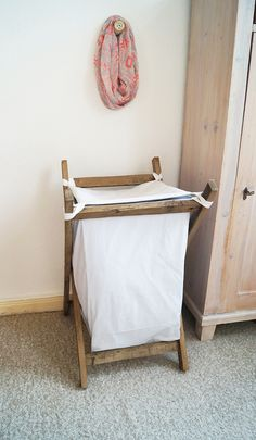 Turn wooden pallets or scrap wood into simple, charmingly rustic laundry storage with this two-part DIY wooden clothes hamper tutorial!