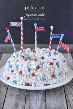 Create a fun and festive polka dot popcorn cake for of July - or any holiday or celebration. Round chocolate candy adds fun flavor and decoration. 4th Of July Party, Fourth Of July, Cupcakes, Cupcake Cakes, Popcorn Cake, Blue Popcorn, Cake Recipes, Dessert Recipes, Snack Recipes