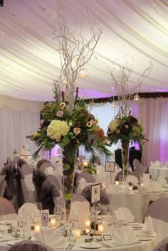 Some of the tables were dressed with tall elegant vases filled with fresh Pears, Fir Cones and Cinnamon sticks and topped with floral magnificence