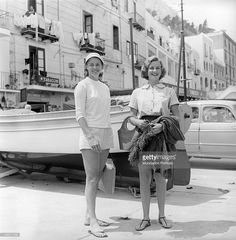 The actress Ingrid Bergman and her daughter Pia Lindstrom in a pose smiling near the pier. Capri, the '50s.