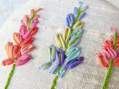 Ribbon embroidery brooch lupin flower brooch button with silk ribbon, pink, purple green on cream silk This silk ribbon embroidery is like a Pillow Embroidery, Silk Ribbon Embroidery, Embroidery Ideas, Embroidery Stitches, Hand Embroidery, Lupine Flowers, Thread Painting, Cushions, Pillows