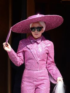 Call it glitter pop. Lady Gaga glistens in pink on March 24 in New York
