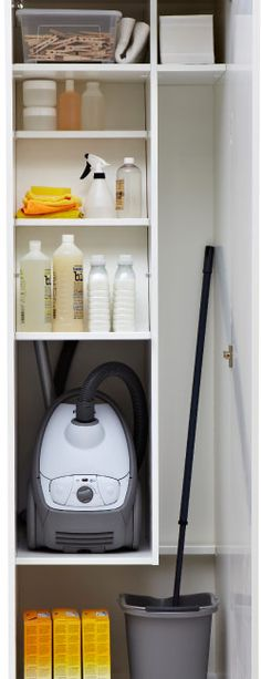 Ikea Organised inside of a cleaning closet - another option for broom/mop storage!