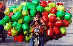 Bucket seller, India. AP Photo/Mahesh Kumar A