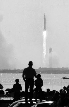 07/16/1969 - Apollo 11 blasted off from Cape Kennedy, FL, and began the first manned mission to land on the moon. Father and son oberve Apollo 11 Launch, Photo by Ralph Crane