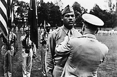 JOE LOUIS, boxing champ becomes a Sergeant in WWII, circa 1943. Documentary called, 'The Real Joe Louis.'