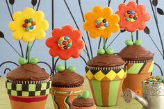 cute centerpiece terra cotta pots holding cupcakes with lollipop sugar cookie flowers