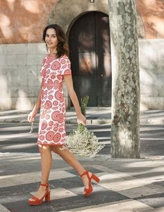The pattern on this cotton broderie dress was exclusively designed in-house, inspired by harvest festival wreaths and leaves. The classic, feminine shape is made extra special with scalloped trims around the sleeves and hem. Pair with heels and a sleek clutch to really up the ante.