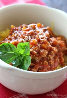 Roasted Spaghetti squash topped with a simple-yet-delicious meat sauce simmered with tomatoes, onions, carrots and celery. I love this low-carb dish, you won't miss the pasta! #whole30 compliant