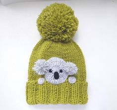 d4530fc8 Knit pom pom hat with crochet Koala applique sewn onto. Cute winter outfit  for kids