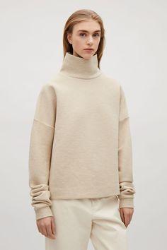 COS image 2 of Oversized high-neck sweatshirt in Biscuit
