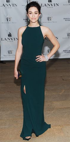 Emmy Rossum scaled back on embellishments and made a stunning entrance at the American Ballet Theatre 2014 Opening Night Spring Gala in a sleek forest green Lanvin column, accessorizing with diamond Van Cleef & Arpels jewelry and a Lanvin metallic box clutch.