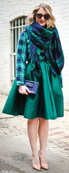 Green skirt. Plaid blouse and scarf