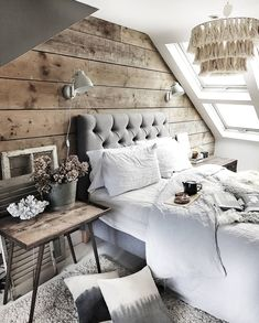 My rustic bedroom makeover with reclaimed scaffold plank wall and grey button back bed from Button & Spring and a boho interiors touch from the tassled chandelier. I have used lots of sheepskins and rugs to create a cosy bedroom with lots of hygge Attic Renovation, Attic Remodel, Attic Spaces, Attic Rooms, Attic Playroom, Attic Apartment, Attic Bed, Attic House, Attic Ladder