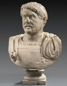 A Roman marble bust of a bearded man in military dress. Hadrianic period, 140 A.D.