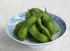 Edamame, healthy snack.  Japanese way to eat them is to just boil and lightly salt them.  Simple is the best.