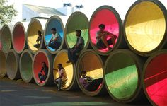 Storm water pipes with colored cellophane. #urban #guerrilla