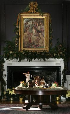 A fireplace is beautifully decorated with live garland. There are no plastic decorations on Boone Hall Plantation.