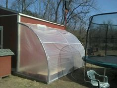 Recycled trampoline greenhouse~~using a 1/4 of the trampoline at each section~~not sure this is the original link