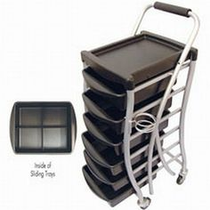 """Celebrity Open Utility Trolley with 6 Trays by Celebrity. $189.59. 6 sliding trays with removable dividers.. Trolley height: 40"""".. Tray size: 15""""x 12""""x 3-1/2"""" deep.. Rubberized handles.. Hairdryer holder.. Celebrity Open Utility Trolley with 6 Trays."""