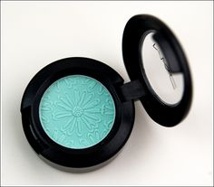 AQUA EYESHADOW - MAC's FASHION FLOWER COLLECTION: a bluish aqua with a matte finish. This is a permanent shade.