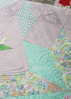 Use quilting to connect the blocks or to make secondary designs in the quilt.
