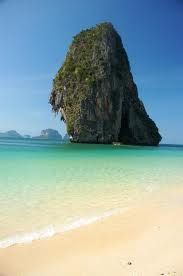 Phra Nang Beach - Krabi.   Fantastick white, powder soft beach with crystal clear water and a great view.     Longtail boats selling food and beverages on the beach