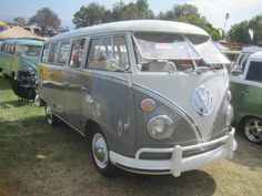 1963 VW Bus - the dove grey with bright white is so sharp looking!  Would not mind a road trip in one of these.