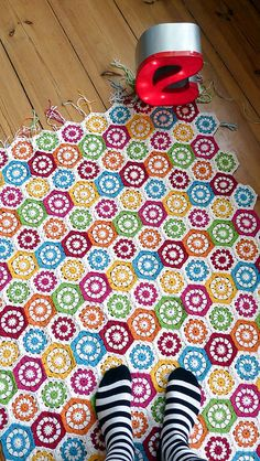 crochet. again would look better with other colors to rainbowish for this rug. Only 2  or three colors should be used and one of those colors should be black or white.