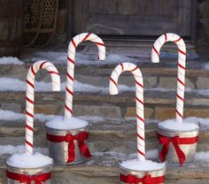 Inspiration: PBK Candy Cane Stakes. Use large plastic candy canes and place in pails to decorate front walkway.