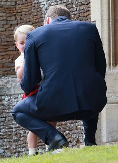 July 2015 ~ Prince William, Duke of Cambridge talks to his son, Prince George, outside the Church of St. Mary Magdalene on the Sandringham Estate for the christening of Princess Charlotte of Cambridge. Prince William And Catherine, Prince William And Kate, Prince And Princess, Princess Kate, Duchess Kate, Duke And Duchess, Prince George Photos, Prince George Alexander Louis, Elisabeth Ii
