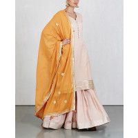 Bring out yourbegumside with this blush pink and silver trimmed sharara set with contrasting mango hued in-seams and dupatta. The dupatta is embellished with tassels and delicate golden tinted flowers. Handcrafted in soft mulmul, this sharara set is a classic mix of vintage sentiments and contemporary versatility. It holds in itself the rich lineage of Mughal fashion that has transcended time. Handcrafted100% Cotton MulmulDelicate & LightweightNatural Colours