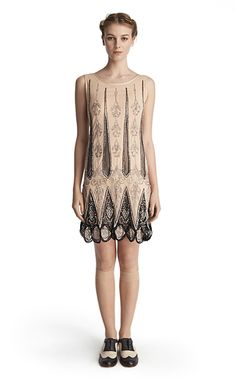 DENNA DRESS - Candela NYC The Denna Dress is a sleeveless modern take on a 1920's flapper dress with scallop beading in hues of rose gold, blush and white. $925