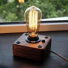 A wooden lamp, in the style of industrial, a steampunk for retro lamps EDISON. The lamp is made by hand from natural wood, polished and covered with Danish oil. Lampe Steampunk, Steampunk Bedroom, Lampada Edison, Desk Lamp, Table Lamp, Luminaire Original, Lampe Retro, Lampe Decoration, Bedroom Lamps