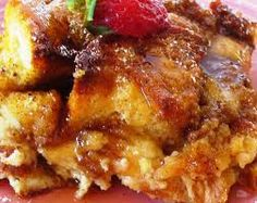 French Toast Casserole  This is easy to make the night before and delicious in the morning!    Cook 1 cup of brown sugar and 1 stick of butter and 2 tblsp corn syrup until syrupy.    Pour into a 9 x 13 inch baking dish.    Spread with 2 tart apples, peeled and sliced.    Layer a loaf of French bread that has been cut i