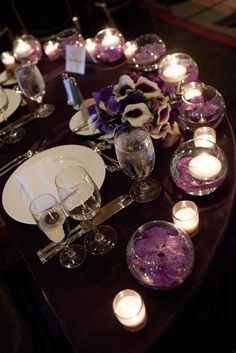 A Sweetheart table with bowls of submerged Vanda Orchid blooms with floating candles and the bridal bouquet in the center at The Loews Hotel, Philadelphia {Design: TableArt   Photo: Susan Beard Design}